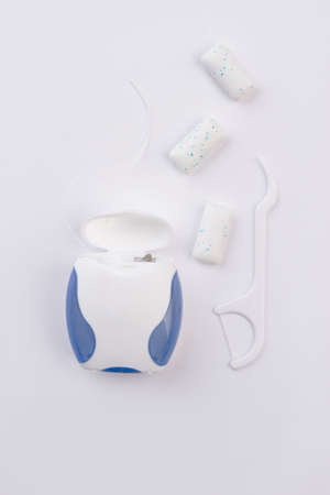 Plastic toothpick, dental floss and chewing gums. Dental floss toothpicks, top view. Instruments for oral hygiene.