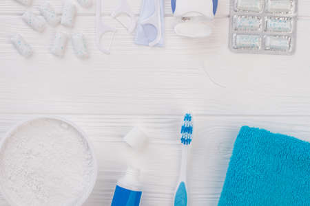 Various dental care products and copy space. Toothpaste, toothbrush, towel, dental floss, toothpick, chewing gums and copy space. Equipment for healthy teeth.