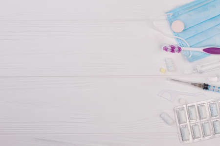 Different dentist tools and copy space. Tooth care with toothbrush, dental floss and dentist instruments. Reklamní fotografie