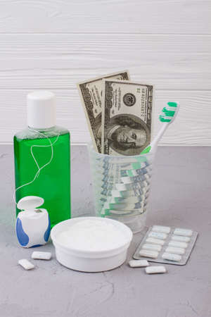 Set of tools for oral hygiene and money. Dental and health care concept. Reklamní fotografie