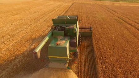 Motion of combine harvester. Boost profits of agribusiness.