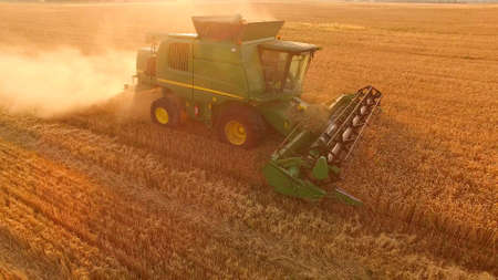 Combine field and sunrise. Reach success in agribusiness.