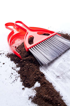 Dustpan, soil and broom on the floor. Concept of cleaning. Stock Photo