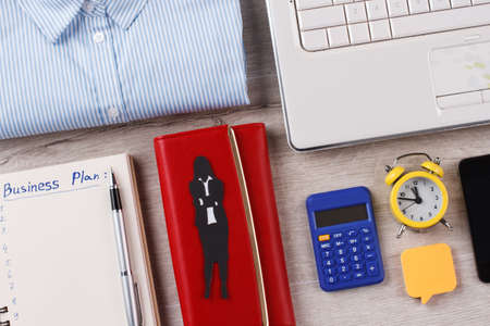 Wallet, calculator and clock close up. Usual things of white collar lady. Office concept. Stok Fotoğraf