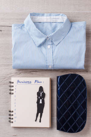 Shirt, case and planner. Successful woman ready to do business. Ready to attend an office.