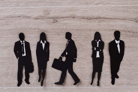 Black paper paper figures of business people.