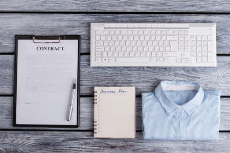 Notepad, pen, shirt and keyboard. Neat clerk's pattern. Office concept.