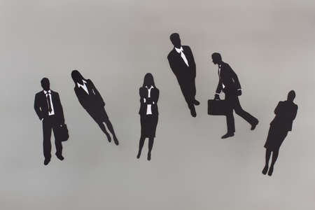 Black paper figures of buisness people. Business collegues. Office team.