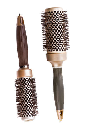 Two round hair brushes, top view. Anti-static hair brushes on white background. Styling essentials for hairdresser.