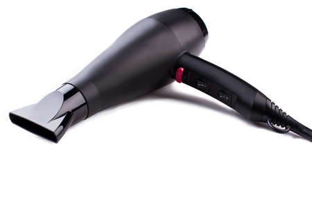 Black hair dryer on white background. Electric hair dryer. Space for text.