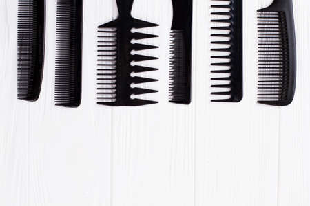 Set of hair combs on white background. Group of black hair combs. Space for text.