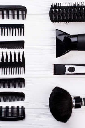 Professional beautician hairdressing tools. Set of barbers accessories on white background. Space for text.