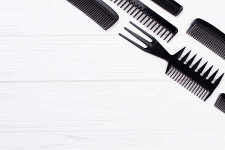 Set of hairdresser combs on white background. Professional hairdresser tools. Space for text.