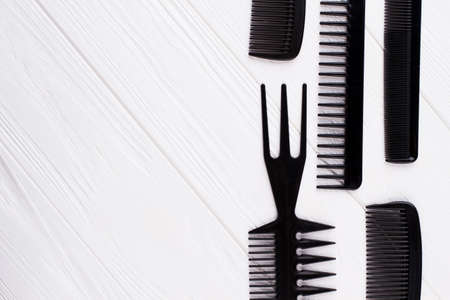 Set of black plastic combs for hair coloring. Set of professional hairdresser tools and copy space. Beauty salon and hairdressing concept. Zdjęcie Seryjne