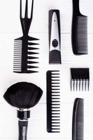 Set of black hairdresser objects on white background. Professional hairdresser tools with combs. Flat lay, top view.