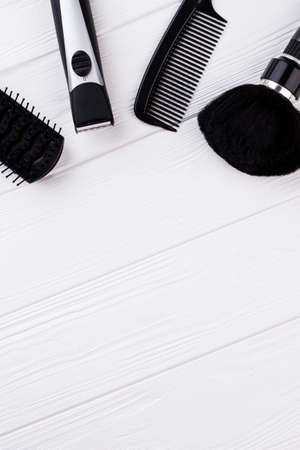 Top view of professional hairdressing equipment. Set of hairdresser tools on white background with copy space. Flat lay, top view.