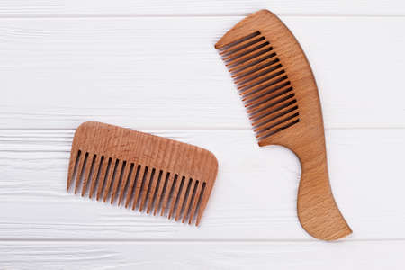 Wooden hair combs on white background. Natural brown hair combs on wooden surface. Zdjęcie Seryjne