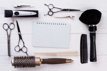 Set of hairdresser tools and blank notebook. Professional hairdresser equipment and paper notepad with copy space. Zdjęcie Seryjne