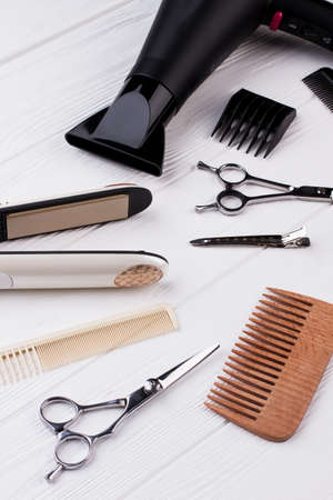 Hairdresser tools on wooden background. Set of hairdresser tools and accessories. Zdjęcie Seryjne