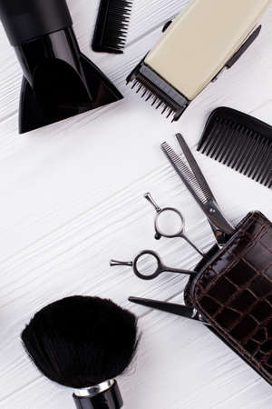 Set of hairdresser tools and accessories. Hairdressing equipment on white wooden table. Space for text. Zdjęcie Seryjne