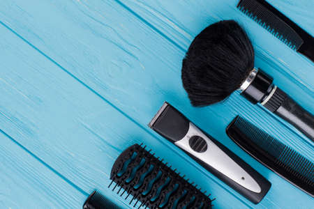 Tools for professional hairdresser on color background. Barber equipment and copy space.