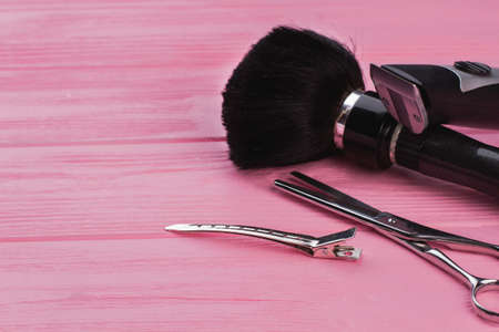 Hairdresser tools on pink background. Professional barber equipment on color wooden surface. Zdjęcie Seryjne