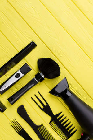 Hairdresser instruments on wooden background. Tools for hairdresser and copy space. Zdjęcie Seryjne