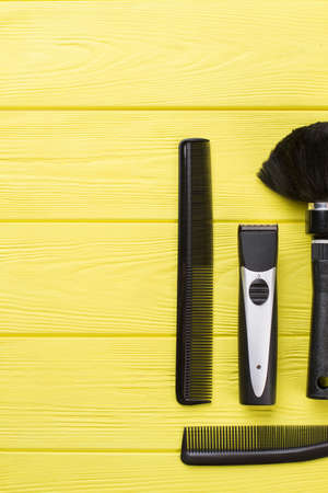 Hairdresser tools on color wooden background. Professional barber equipment on color table. Space for text.