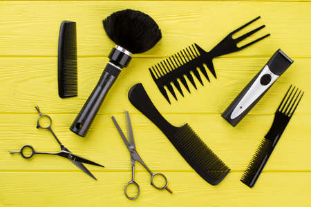 Stylish professional hairdresser tools on color background. Hairdresser workspace with equipment. Styling hair in barbershop.