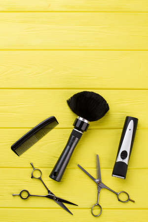Hairdresser tools on wooden background. Top view of professional barber equipment. Space for text.