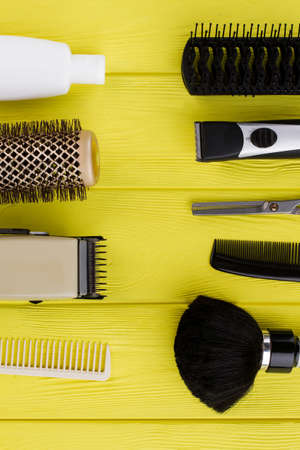 Flat lay with tools for professional hairdresser. Top view of hairdresser equipment on color background. Space for text. Zdjęcie Seryjne