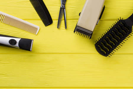 Hairdresser accessories on color background. Professional hairdresser tools. Space for text. Zdjęcie Seryjne