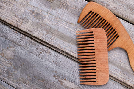 Wooden hair combs and copy space. Handbag combs on wooden background.