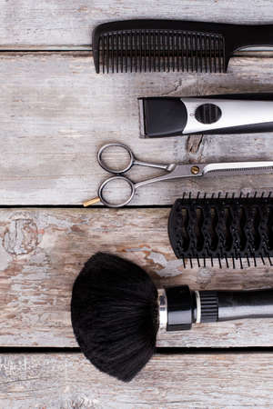 Professional hairdresser tools. Barber equipment on wooden background. Preparation for cutting hair.