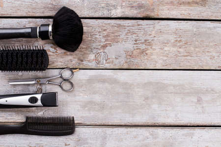 Professional hairdresser tools. Combs, hair brushes, scissors and electric trimmer. Space for text. Zdjęcie Seryjne