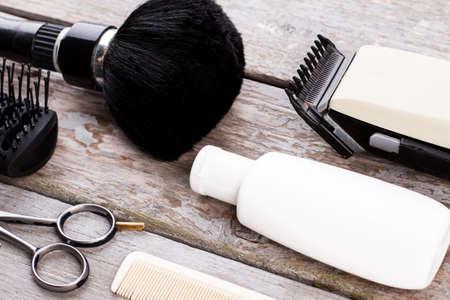 Hair cut tools set for men. Scissors, brush, electric clipper and shampoo on wooden background. Men hair salon. Zdjęcie Seryjne