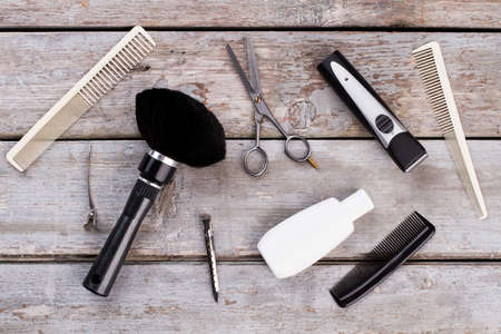Haircut tools set for men, top view. Various barber tools on vintage wooden background.