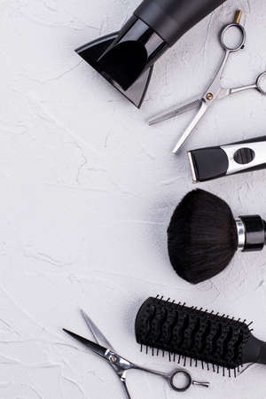 Hairdresser set with various accessories, top view. Hair dryer, scissors, clipper and brush. Tools in beauty salon. Zdjęcie Seryjne