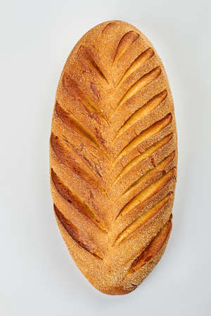 Freshly baked french bread, top view. Loaf of bread isolated on white background. Natural bread recipe.