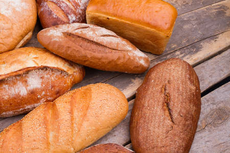 Bread on rustic wooden background. Bread bakery background.