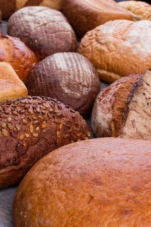 Mixed homemade organic bread close up. Healthy grain organic gourmet bread. Stock Photo
