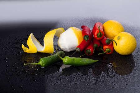 Bunch of chili and lemon trio. Nuclear union of tastes. Food concept. 版權商用圖片