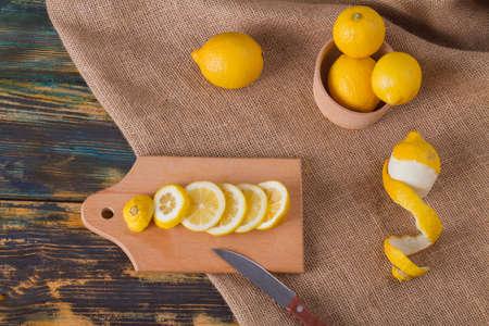 Mono still-life from lemons. Sliced citrus on cutting board. Atomic vitamin C.