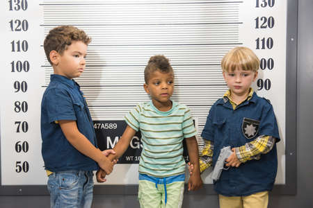 Childrens role play center. Little boys playing police and thief indoor. Activity center for kids.