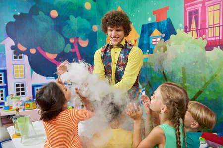 31.07.2017 - Kyiv, Ukraine. Animator with happy children indoor. Chemistry Birthday party. Kids entertainment center.