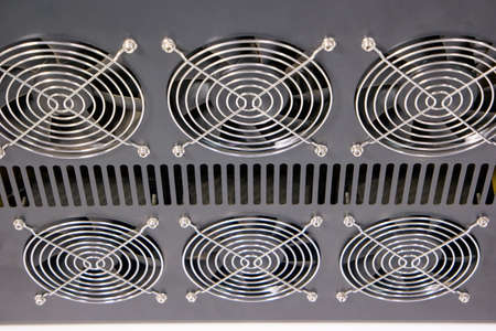 Set of six cooler radiators fans. Cooling fan system. Stock Photo