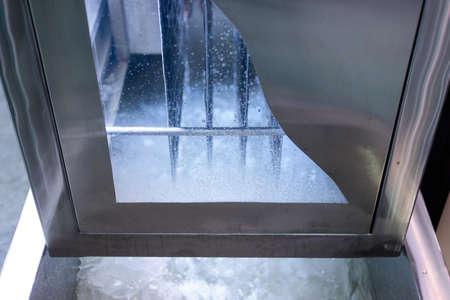 Ice making machine window. Making clean cool ice.