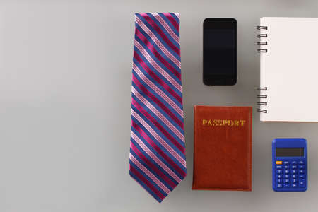 Mens personal stuff, tie and stationery. Planning a business related trip. Working moments.
