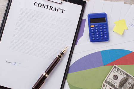 Contract, calculator and sticker. Increasing of working indicators. Profit for the company