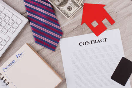 Contract with various items. Tie, notebook and money. Paper stuff and keyboard. Business concept. Banco de Imagens